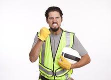 Porträt eines verärgerten Bauarbeiters mit der geballten Faust wieder Lizenzfreies Stockfoto