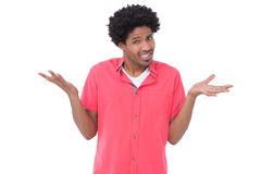 Porträt eines verwirrten Manngestikulierens Lizenzfreie Stockbilder