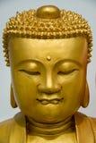 Porträt goldener Budda-Statue Lizenzfreies Stockfoto