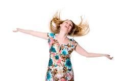Porträt netter glücklicher junger Dame, die ihre Arme verbreitet Stockfoto