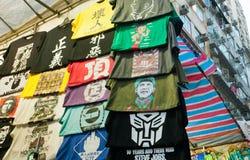 Porträt von Barack Obama als chinesischen Führer in der Masse von T-Shirts Stockfoto
