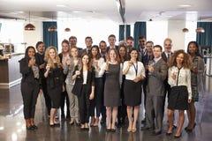 Porträt von Delegierten bei der Konferenz trinkt Aufnahme lizenzfreie stockfotografie