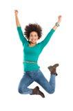 Die Frau springend in Freude lizenzfreie stockbilder