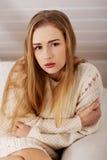 Portraif of beautiful sad, worried caucasian woman. Portraif of beautiful sad, worried caucasian woman in bright sweater Stock Photo