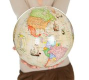 Portrail of beautiful woman holding a globe Royalty Free Stock Photography