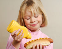 Portrail little girl with hot dog. Stock Photography