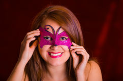 Portrain of beautiful model woman wearing pink carnival mask Royalty Free Stock Images