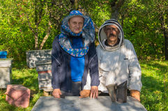 Portrain of Ukrainian bee-keeper and his assistant Royalty Free Stock Images