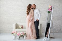 Portraint of pregnant woman and her husband at studio Royalty Free Stock Photo