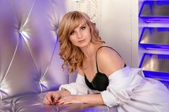 Portrair of beautiful blonde woman in black bra Royalty Free Stock Photography