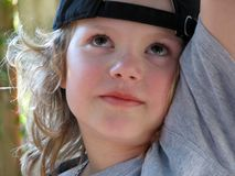 Portrair of a Boy. Portrait of a ten years old boy with long hair royalty free stock photos