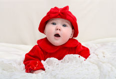 Cute little baby with a surprised face expression Royalty Free Stock Photography