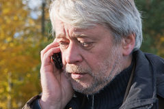 Portrair Of Mature Middle-aged Man In Forest. Royalty Free Stock Images