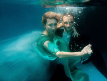Free Portrair Of Young Dancing Couple Underwater Stock Photo - 61661900