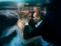 Portrair of young dancing couple underwater Stock Images