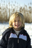 Portrait. Of a young boy in the sun on a winterday Stock Photography