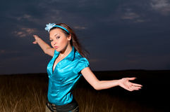 Portrait. Of young woman against the evening sky Stock Photography