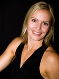 Portrait. Woman in a black dress smiling Royalty Free Stock Images