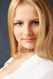 Portrait. A blond girl looking at light Royalty Free Stock Images