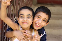 Portrait of 2 boys playing and laughing, street background in giza, egypt. Portrait of 2 boys playing, street background in Giza, Happy kids playing in the Stock Image