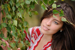 Portrait. Of a beautiful girl with big gray-green eyes near birch Stock Image