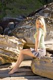 Portrait. Blond girl in green on sandstone background Royalty Free Stock Photography