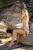 Portrait. Blond girl in green on sandstone background Stock Images