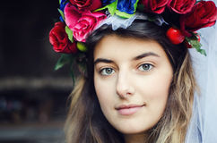 Portrait. Of a beautiful young women outdoors with flower turban on her head Royalty Free Stock Photography