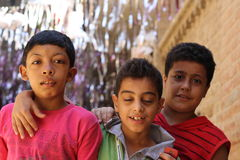 Portrait of 3 boy friends in street in giza, egypt Stock Photos