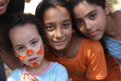 Happy young children. Three happy young girls, one with painted face, Giza, Egypt Royalty Free Stock Images