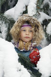Portrait. Of the little girl in fur-trees Royalty Free Stock Photos