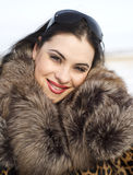 Portrait. Beauty woman in leopard fur coat Stock Images