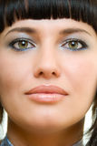 Portrait. Of pretty brunette with light over and front of the model Royalty Free Stock Image
