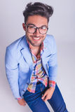 Portrait from above of sexy casual man wearing glasses. And looking at the camera in studio background Royalty Free Stock Image