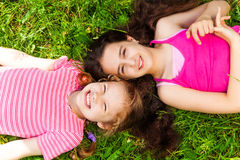 Portrait from above of two beautiful girls Stock Photos
