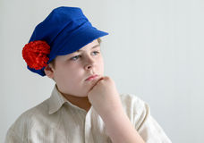 Portrait of aboy teenager in Russian national cap with cloves Royalty Free Stock Images