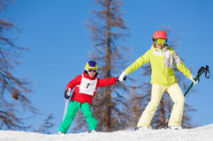 Portrait of active family skiing holding hands royalty free stock photography