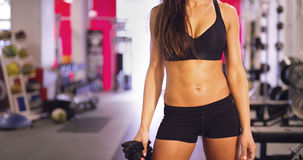 Portrait of active fitness woman`s waist and well trained stomach royalty free stock photo