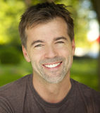Portrait Of A Active Man Smiling At The Camera stock photos