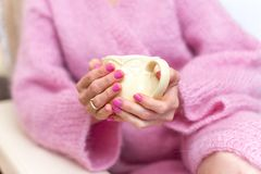 An active middle age woman drinking coffee in a bathrobe. Portrait of an active middle age woman drinking coffee in a bathrobe stock image