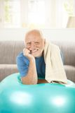 Portrait of active senior with fit ball Royalty Free Stock Photos