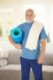 Portrait of active senior going to gym. In sportswear with polyfoam, smiling Stock Images