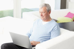 Portrait of active senior man. Close-up of active senior man working at home. Small business Royalty Free Stock Photos