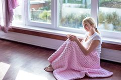An active senior woman drinking coffee in a bathrobe stock image
