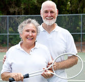 Portrait of Active Seniors. Portrait of an active senior couple on the tennis courts Royalty Free Stock Photography