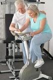 Portrait of active smiling senior couple exercising stock images