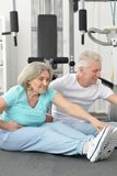 Portrait of active smiling senior couple exercising stock photos