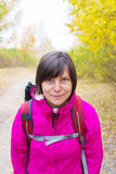 Portrait of an active woman with a backpack in autumn wood. Stock Images