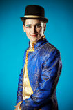 Portrait of the actor. On a blue background. Actor in makeup, a blue suit and black hat Stock Image