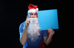 Portrait actor male in cap and beard of Santa Claus with a sheet of paper for notes in the hands Stock Image
